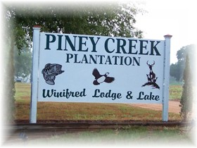 Piney Creek Plantation Winifred Lodge and Lake sign at Hog Hunting Lodging